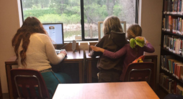 Teens and kids sitting at computer desks